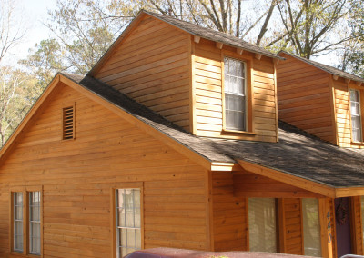 "Cypress siding.<br/> <span class=""gallery-courtesy"">Courtesy Acadian Cypress and Hardwoods</span>"