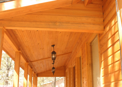 Cypress siding, ceiling, and beams. Courtesy Acadian Cypress and Hardwoods