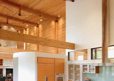 Interior view of cypress log home with cypress walls, ceiling, beams, and cabinetry. Courtesy Craig Thompson